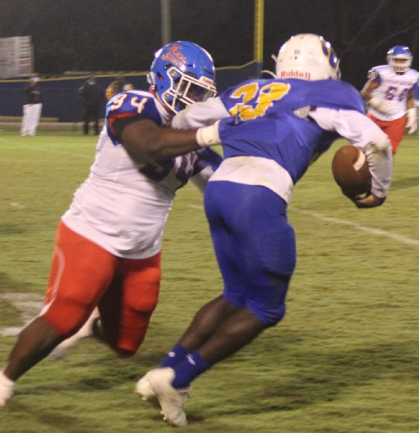 Noxubee County senior defensive lineman Travorus Hatcher tackles Hatley senior running back Markhel Hunt during Friday's game in Amory. Noxubee County won 60-0.