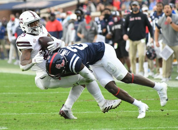 Mississippi State running back Dillon Johnson (23) is tackled by Ole Miss defensive back A.J. Finley (21) during Saturday's Egg Bowl at Vaught-Hemingway Stadium in Oxford.