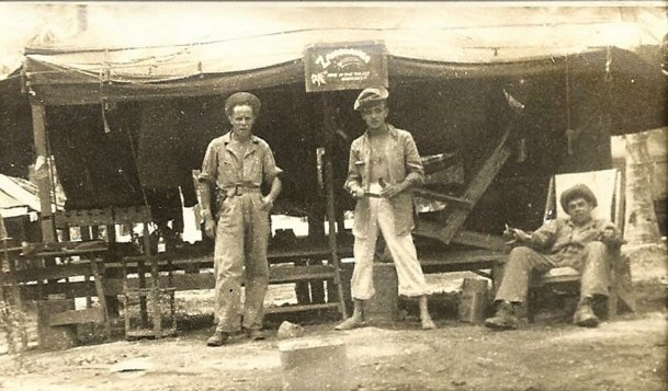 The camp of the Seabees of the 113th Naval Construction Battalion, at Zamboanga in the Philippians in May of 1945. The camp's name on the tent says