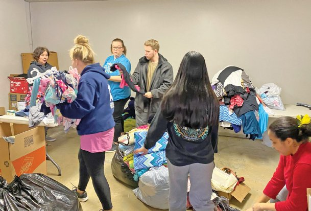 From left, Cindy Beam, Abby Wesling, Tracey Williams, Jameson Holder, Bethany Setiawan and LeTeria Whitaker sort through donations for The Exchange, a newly-opened thrift store operated by The Assembly church at 2201 Military Road. The Exchange is open every Friday and Saturday from 10 a.m.-6 p.m., open to everyone.