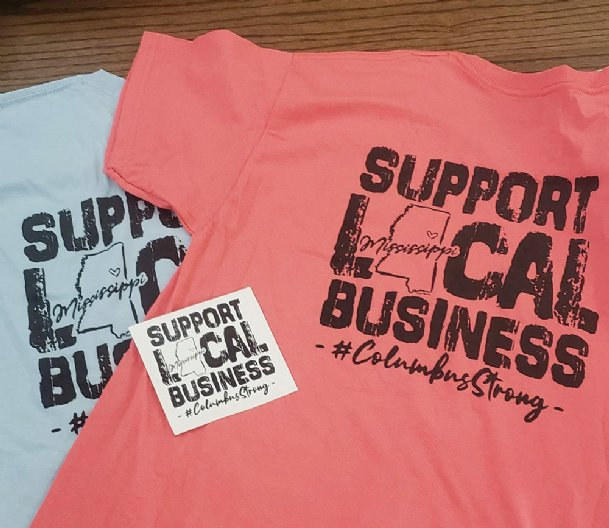 Main Street Columbus offers T-shirts supporting downtown businesses in six colors, including coral silk and gray.