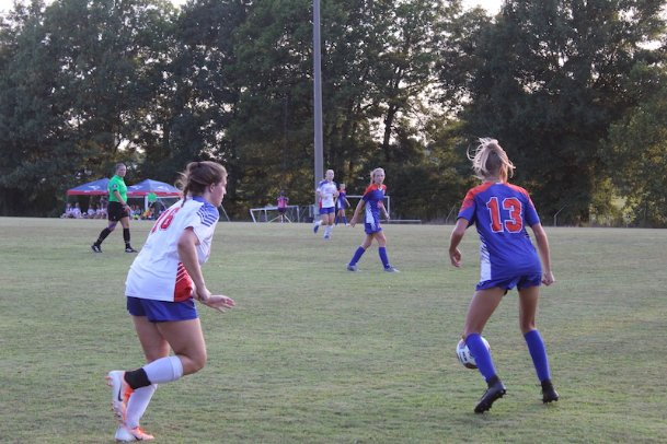 Heritage Academy's Lilly Grace Gunter (16) defends Starkville Academy's Mia Kate Cade (13) early in the second half of Thursday's match between the two rival schools. Cade scored in the second minute for the only goal of the match.