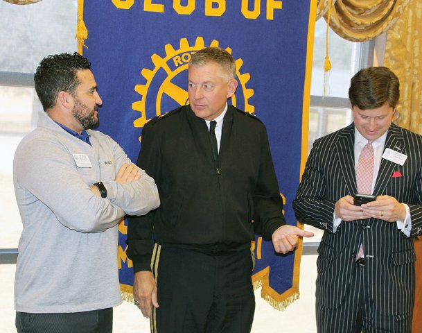 Major Gen. Janson Boyles, adjutant general for the Mississippi National Guard, visits with Columbus Rotarians Jimmy Parker, left, and Corky Smith, right, after speaking to the club Tuesday at Lion Hills Center. Boyles touted the operational readiness of the National Guard and its economic impact for the state.