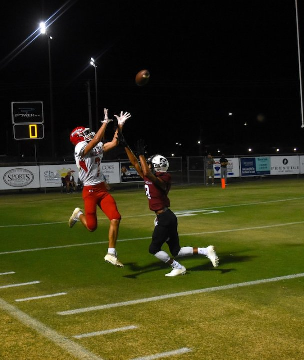 Heritage Academy wide receiver Mitchell Woodard (7) catches a pass over Caledonia defensive back Anthony Fason (8) on Friday in Caledonia. Heritage Academy won 28-21.