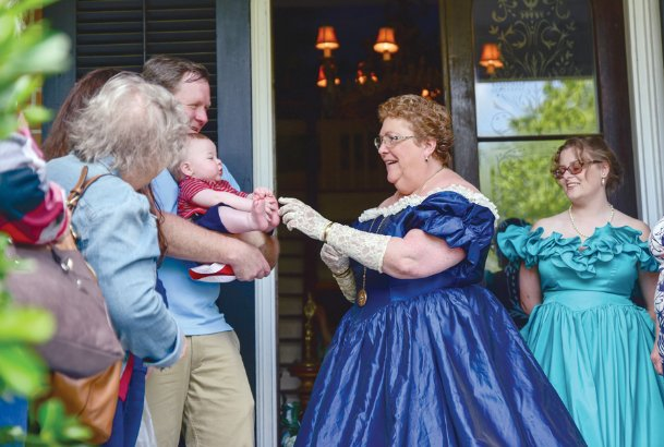 Rachel George, owner of Baskerville Manor, greets visitors in front of her home during the 2018 Pilgrimage in this Dispatch file photo. There are only eight confirmed homes on Pilgrimage's home tours this year.