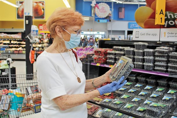 Adeline Fendley of Columbus looks over blueberries in a local grocery Tuesday. July is National Blueberry Month. Read on for ways to use the nutrient-packed fruit you may not have tried before.