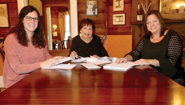From left, Renee Phillips, Lucy Phillips and Lisa Kerby mail out notices saying the Country Store Bake Sale at the S.D. Lee Home has been canceled for this year. Donations toward upkeep of the historic home and museum in Columbus are still appreciated.