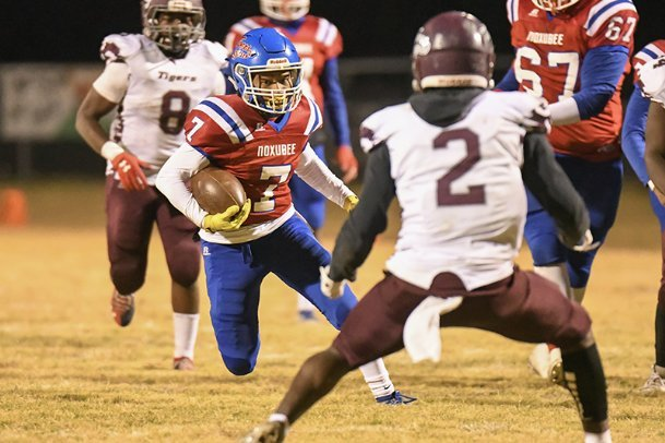 Noxubee County tailback Damian Verdell (7) finds a hole after great blocking from the Tigers' offensive line in a playoff game against Coahoma Agricultural on Nov. 8, 2019, in Macon. Verdell will be available for the Tigers' state championship game against Magee after suffering a mild concussion in Noxubee County's north state semifinal against North Panola.