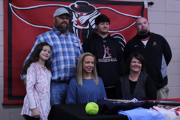 Carley Wooten (front middle) signed her letter of intent to play softball at Mississippi University for Women on Tuesday morning. Softball coach Mitch Bohon (back right) and Wooten's family joined her.