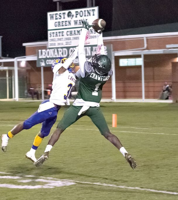 LEFT: West Point receiver Shun Crawford (1) tries to haul in a pass against Canton.