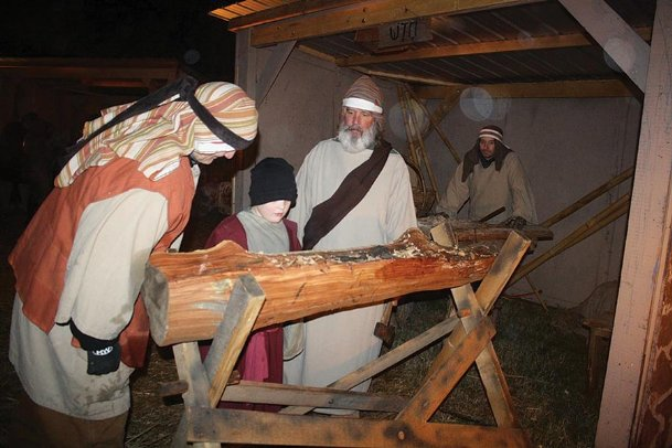 First Baptist Church's First Christmas in Columbus annually recreates a village reminiscent of Bethlehem of old, filled with merchants, villagers and the holy family. Pictured at a previous production are, from left, Mitch Griffin, an unidentified carpenter's apprentice, David Gatewood and Chris Bonner.