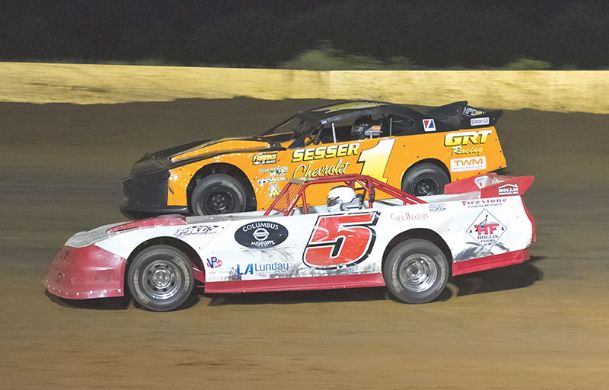 Johnny Stokes (1) holds off Jason Hollis on the next-to-last lap of the Mississippi Street Stock Series $1,000-to-win feature Friday at Columbus Speedway.