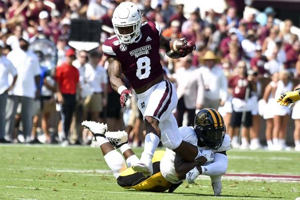Mississippi State Bulldogs running back Kylin Hill (8) runs the ball while defended by Southern Miss Golden Eagles defensive back D.Q. Thomas (12) during the first quarter Saturday at Davis Wade Stadium.