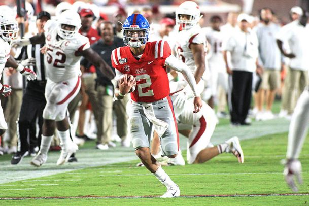 Ole Miss quarterback Matt Corral runs for a first down during the first half Saturday against Arkansas at Vaught-Hemingway Stadium in Oxford.