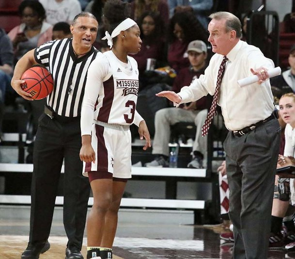 Mississippi State head coach Vic Schaefer talks to Aliyah Matharu (3) during a time-out in the first half of their NCAA college basketball game against Arkansas Thursday in Starkville.