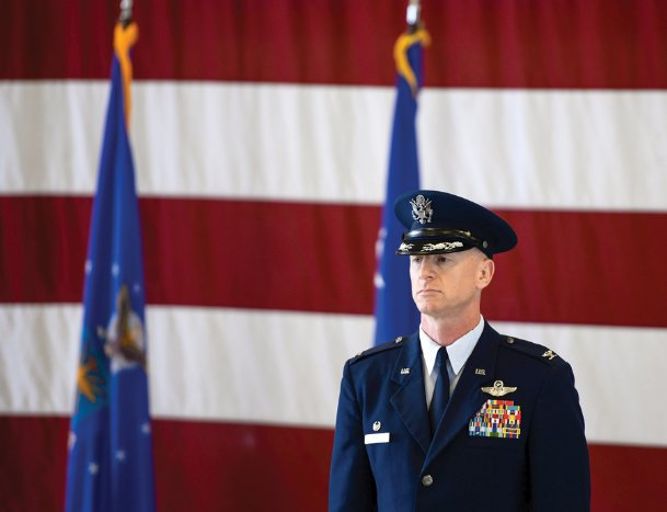 Col. Seth Graham stands at attention during Monday's change of command ceremony at Columbus Air Force Base. Graham takes over as commander at the 14th Flying Training Wing from Col. Samantha Weeks, who has retired. He will assume his duties in July after completing his current training in San Antonio, Texas.