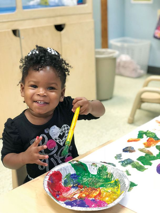 Natalie Jones, 2, paints at Mississippi University for Women's Child and Parent Development Center, which focuses on a curriculum that prepares children for kindergarten. She is the daughter of Amber and Joshua Jones.