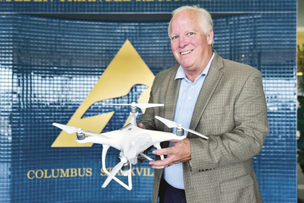 Golden Triangle Regional Airport Executive Director Mike Hainsey holds a quadcopter Thursday at the airport. The drone, or UAS — unmanned aircraft system — derives the name from its four rotors. GTRA and Columbus Air Force Base are partnering to spread the word about guidelines and new regulations that affect the drone-flying public. The quadcopter is on loan from Mississippi State University, which is designated as a National Center of Excellence for Unmanned Aircraft Systems by the Federal Aviation Administration.