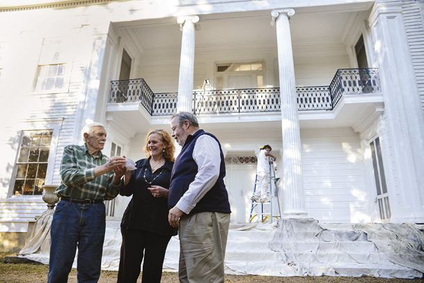Bob Raymond, right, stands outside of Waverley Mansion in this 2014 Dispatch file photo with the old Clay County home's owners, Robert Snow and Melanie Snow. The mansion is now on the market.