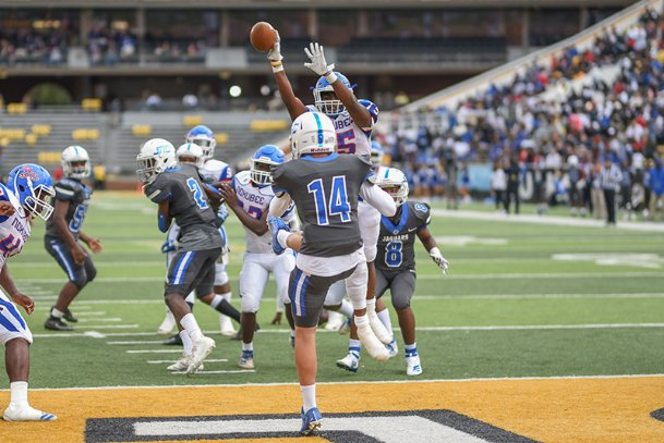 Noxubee County's Jaylon Barnett (15) blocks a punt late in the 4th quarter of Friday's state championship game.