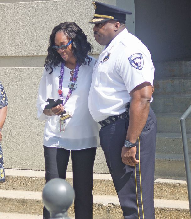 Youlander Johnson, mother of former Hattiesburg Police Department officer Liquori Tate, holds a cross during a Tuesday police officer memorial service at the Starkville Police Department. Police Chief Frank Nichols presented the cross to Jackson in recognition of Tate's, a Starkville native, service.