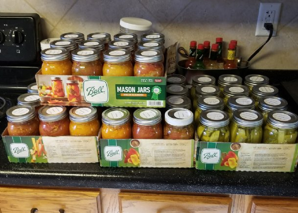 Canning produce for later consumption and giving it away are both good uses for a plentiful garden harvest.