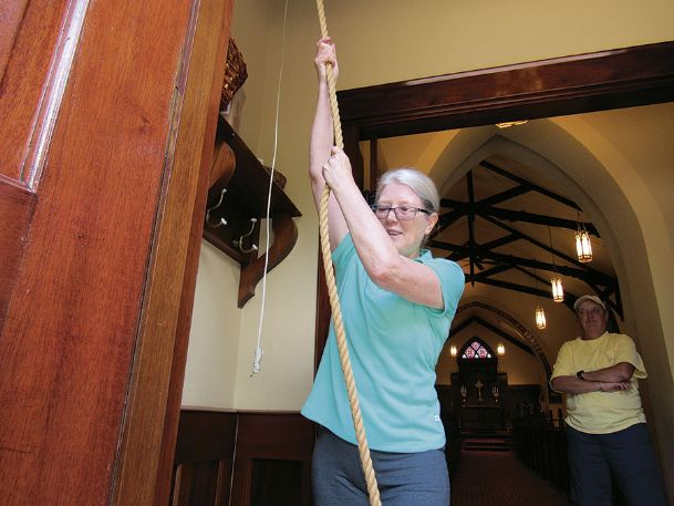 Rev. Anne Harris, St. Paul's Episcopal Church rector, rings the church's bell at noon Tuesday in memory of civil rights activist Medgar Evers. Evers, who received many death threats because of his work, was assassinated outside his home in Jackson on June 12, 1963.