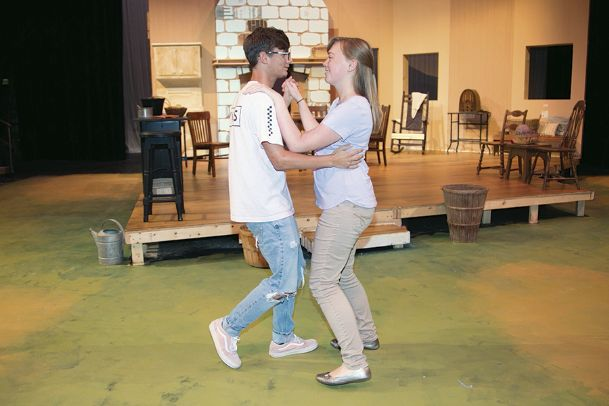 "Cast members Drew Nunley and Katie Ballinger rehearse a scene from ""Dancing at Lughnasa� Monday evening at Mississippi University for Women."