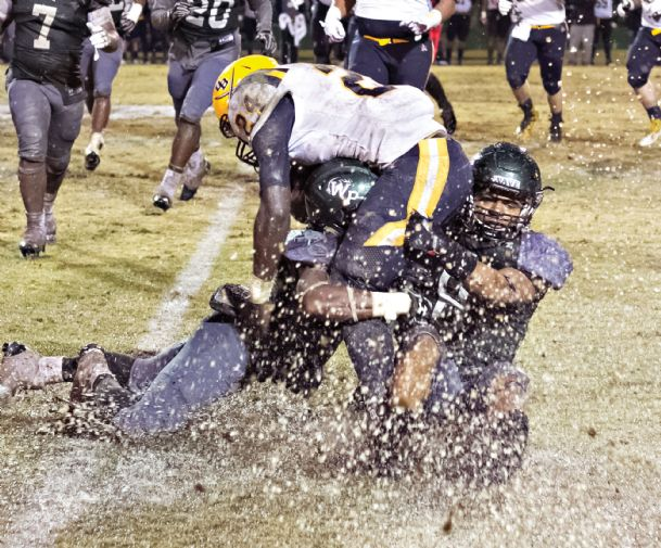 West Point High School defenders Quantaze Powell and Brandon Lairy tackle Olive Branch running back Gary Banks for no gain in their game Friday night in West Point.