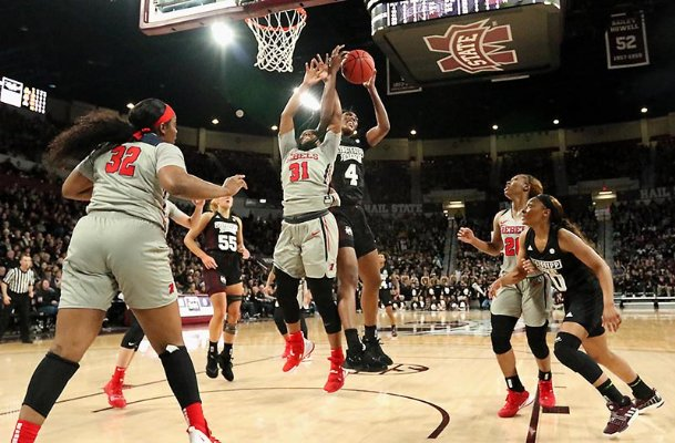 Mississippi State's Jessika Carter fights for a rebound with Ole Miss' Deja Cage during the first half Sunday in Starkville.