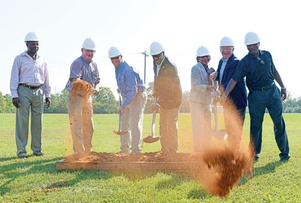 From left to right, District 3 Noxubee County Supervisor Sherman Patterson, Noxubee County Board of Supervisors President Eddie Coleman, Superior Catfish General Manager Fred Johnson, District 42 Rep. Carl Mickens, Merlinda Oliver, Chief Economic Developer Micky Milligan and District 1 Supervisor Larry Tate toss dirt in the air during a groundbreaking ceremony Tuesday at Superior Catfish in Macon. The expansion of the plant will create an additional 25 jobs.