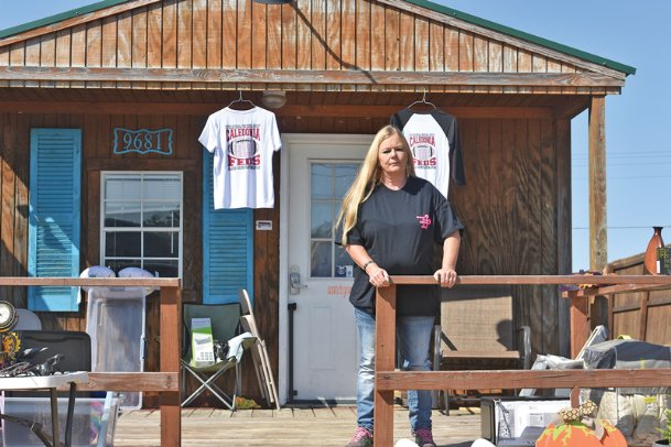 Caledonia resident Tamara Jacobs stands outside of her shop in Caledonia Friday afternoon. She started local nonprofit Carpenters for Christ, which focuses on helping women continue to fight drug addiction after they have been released from jail or rehab. The nonprofit plans soon to build a