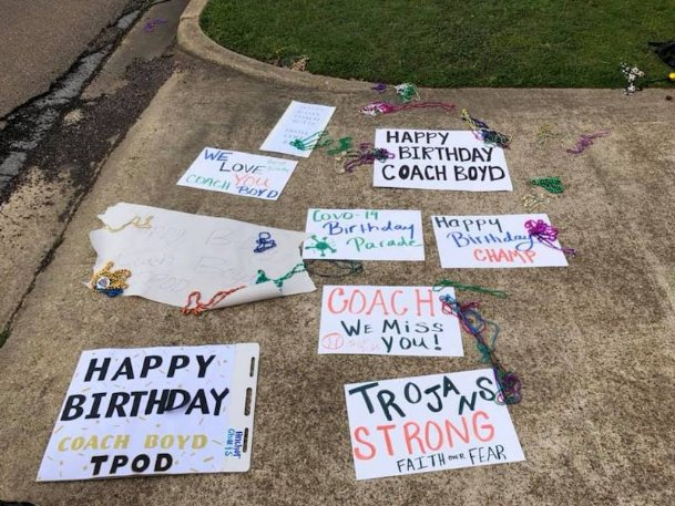New Hope baseball players and their families waved these signs outside the house of head coach Lee Boyd on Sunday, forming a surprise parade in honor of Boyd's 37th birthday. With the spring season suspended due to the coronavirus, Boyd hadn't seen his players since their game March 11 in Biloxi.