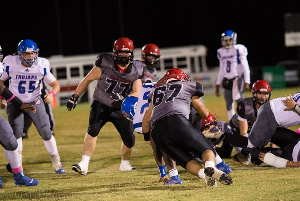Oak Hill Academy linebacker Jaden Craven makes a tackle against Central Holmes Christian on Oct. 18. Craven received the NFL Way to Play award for a tackle he made that night against the Trojans.