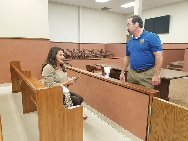 District 4 Supervisor Bricklee Miller chats with Circuit Clerk Tony Rook early Wednesday morning at the circuit courthouse after absentee ballots were counted and solidified Miller's re-election win. She ran against Daniel Jackson, whom she unseated four years ago.