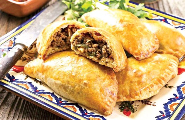 Savory or sweet fillings for empanadas are limited only by your imagination. Fried or baked, use them as the focus of a filling meal, or choose a mini version for appetizers or desserts.