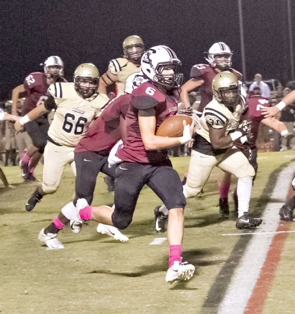 Caledonia High School quarterback Brandon Edmonson runs the ball against Amory on Friday night. Edmondson had 13 carries for 72 yards and a touchdown.