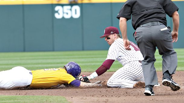 Mississippi State's Jordan Westburg (11) picks off LSU's Chris Reid (4) at 2nd base during the 4th inning of their game Saturday in Starkville.
