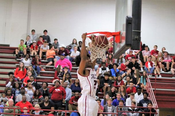 Chase Neal, a Caledonia High School basketball player, dunks a basketball in this undated courtesy photo. Neal claims he was suspended from school for not properly saluting the American flag during the playing of the national anthem at a school event this week.