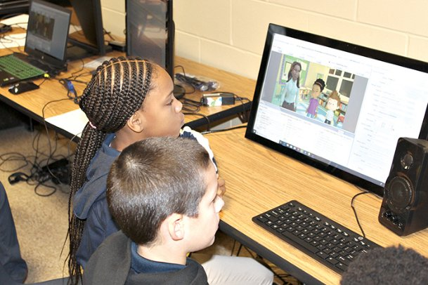 Joe Cook Elementary fifth-graders Dariyah Hill, left, and Easton Sime work on animating characters Tuesday on the Story Maker software platform. With the software, students can voice characters, control their gestures and much more.