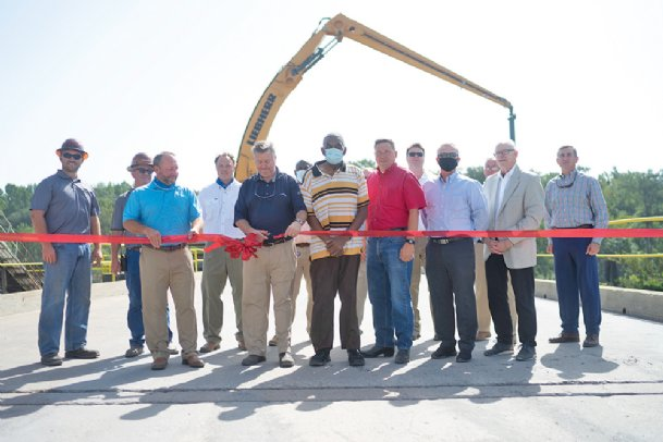 A ribbon is cut in celebration of new equipment for the Lowndes County Port on Thursday in Columbus. The new equipment cost $1.2 million and was funded through a matching grant from MDOT. At more than $700,000, it is the largest MDOT ever granted to the port.