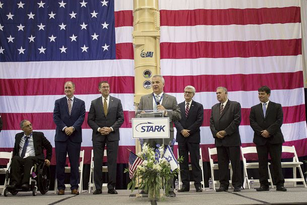 Stark Aerospace CEO Tom Ronaldi, flanked by Mississippi and Israeli officials, thanks guests for attending a commemoration event for the delivery of a missile defense canister to Israel. The canister, located behind Ronaldi, is part of the Arrow 3 missile defense system, which is geared toward intercepting ballistic missiles.