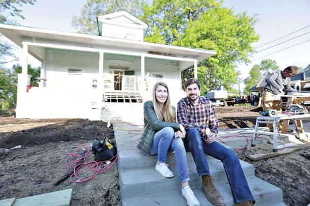 "Amanda Kelly and her brother Austin Shafer sit outside a home on Worley Street in Starkville for which they recently led renovations. The work is chronicled on a pilot episode for ""Hammer to the Manor,� which will premiere Sunday on HGTV."