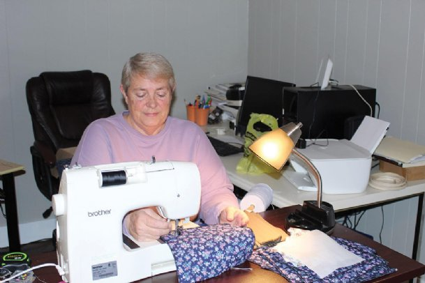 Debby Lawrence of Lowndes County makes masks at her sewing machine Wednesday. To date, she has sewn almost 400 masks to donate and help slow the spread of COVID-19.
