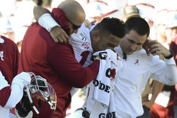 Alabama quarterback Tua Tagovailoa is assisted by team personnel after an injury during the second quarter of Saturday's game against Mississippi State at Davis Wade Stadium in Starkville.