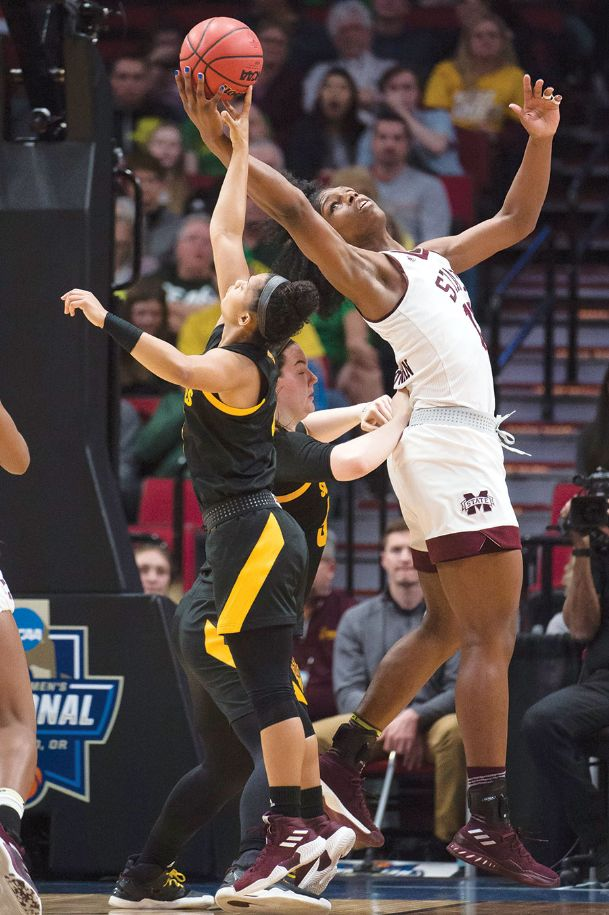 Mississippi State Bulldogs center Teaira McCowan (15) controls an offensive rebound against Arizona State Sun Devils guard Kiara Russell (4) during the first half in the semifinals of the Portland regional in the women's 2019 NCAA Tournament at Moda Center on Friday in Portland, Oregon.