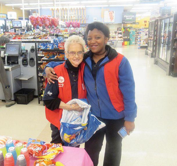 Columbus Kroger greeter Ann Wozniak said she loves working with fellow associates such as Quanisha Travis, right.