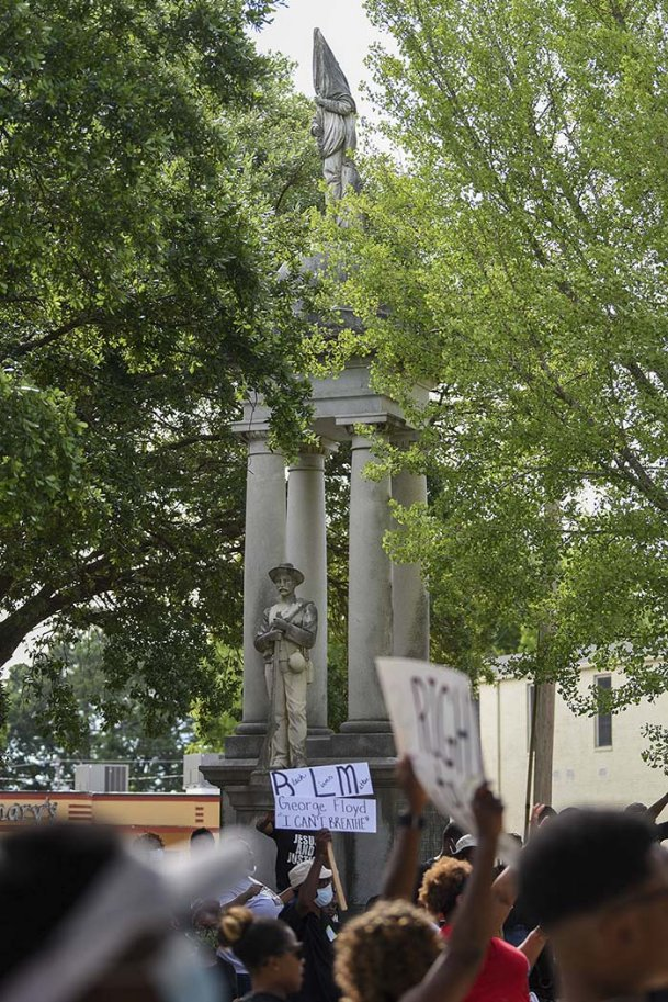 Protesters in June call for the removal of the Confederate monument in front of Lowndes County Courthouse. Though county supervisors originally voted to leave the monument in place, they voted unanimously on Monday to relocate it to Friendship Cemetery.