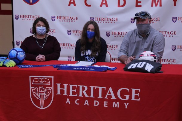 Haven Tuggle, pictured with her parents, Shelley Tuggle and Jonathan Tuggle, signed to play soccer at Mississippi University for Women on Thursday. The Heritage Academy senior goalkeeper hopes to play the same position in college but is willing to contribute in the field if needed.