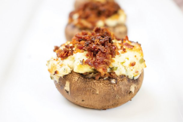 Blue cheese and bacon stuffed mushrooms boast fresh chives, crisp onions, mushrooms and, of course, blue cheese and delicious bacon.